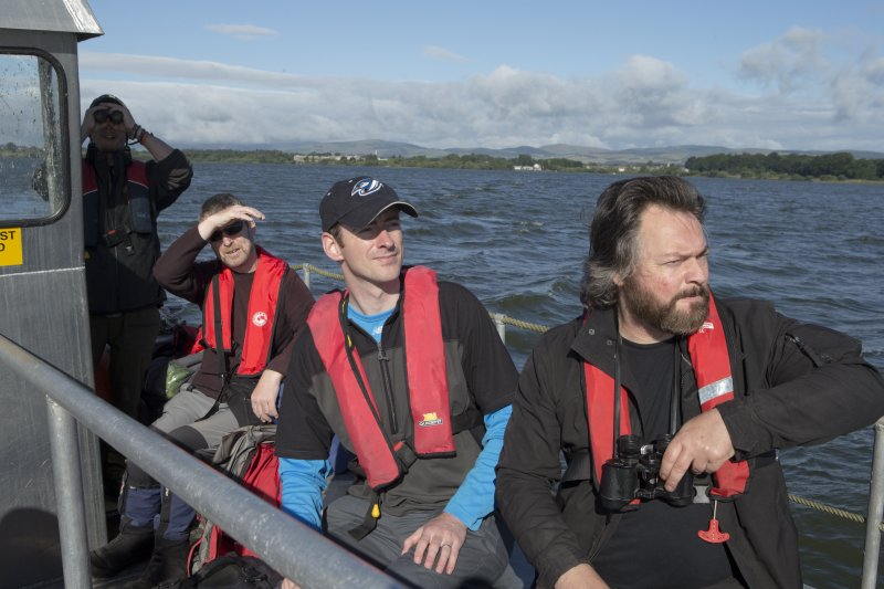 RCAHMS staff and volunteers in boat travelling to St. Serf's Island