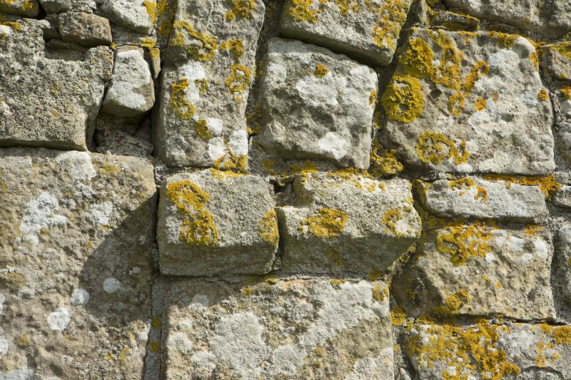 Detail of stonework at springing of arch on west face of priory church