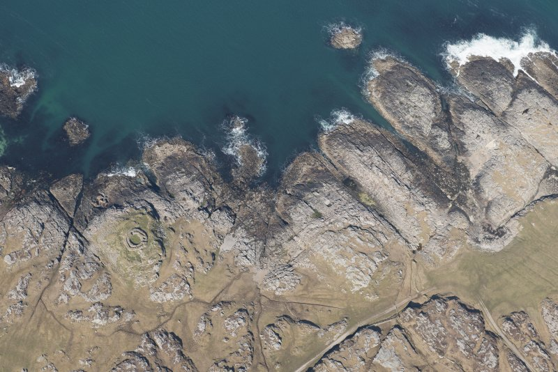 Oblique aerial view of Vaul, Dun Beag, Tiree, looking N.