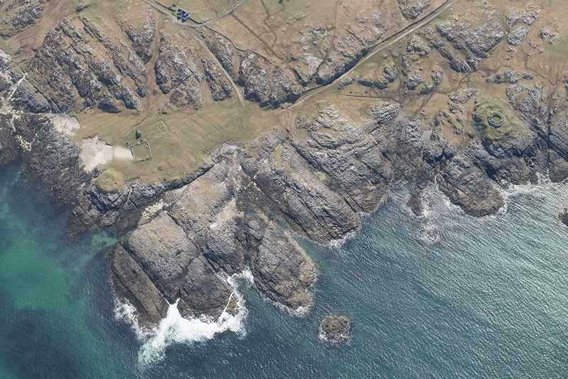 Oblique aerial view of Vaul, Dun Beag, Tiree, looking SW.