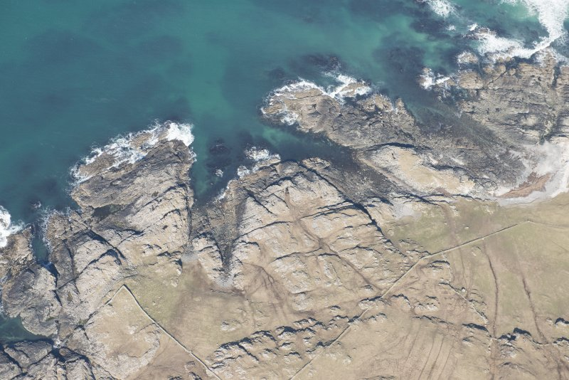 Oblique aerial view of Dun Boraige and Dun Moire, Tiree, looking NNE.