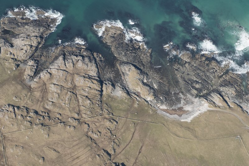 Oblique aerial view of Dun Boraige, Tiree, looking N.