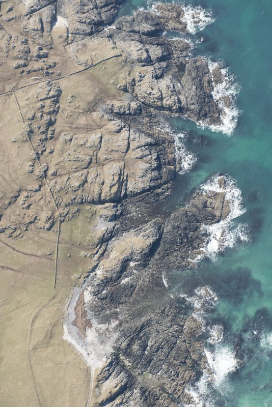 Oblique aerial view of Dun Boraige and Dun Moire, Tiree, looking W.