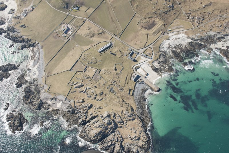 Oblique aerial view of Hynish, Tiree, looking NW.