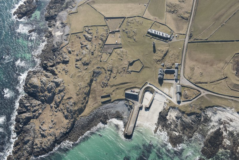 Oblique aerial view of Hynish, Tiree, looking SW.