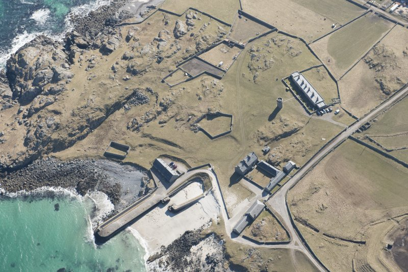 Oblique aerial view of Hynish, Tiree, looking S.