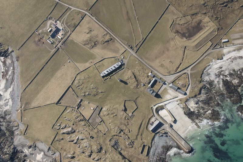 Oblique aerial view of Hynish, Tiree, looking W.