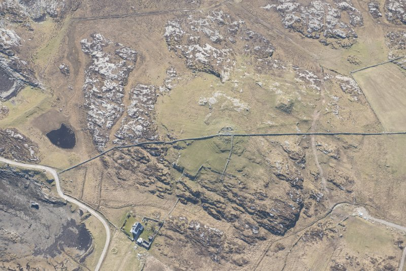 Oblique aerial view of Dun Mor a' Chaolais, Millton, Tiree, looking SW.