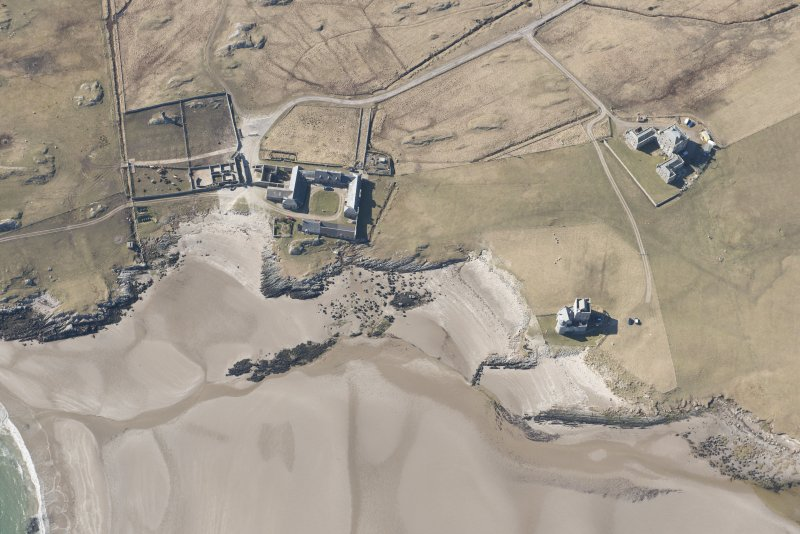 Oblique aerial view of Breachacha, Coll, looking WNW.