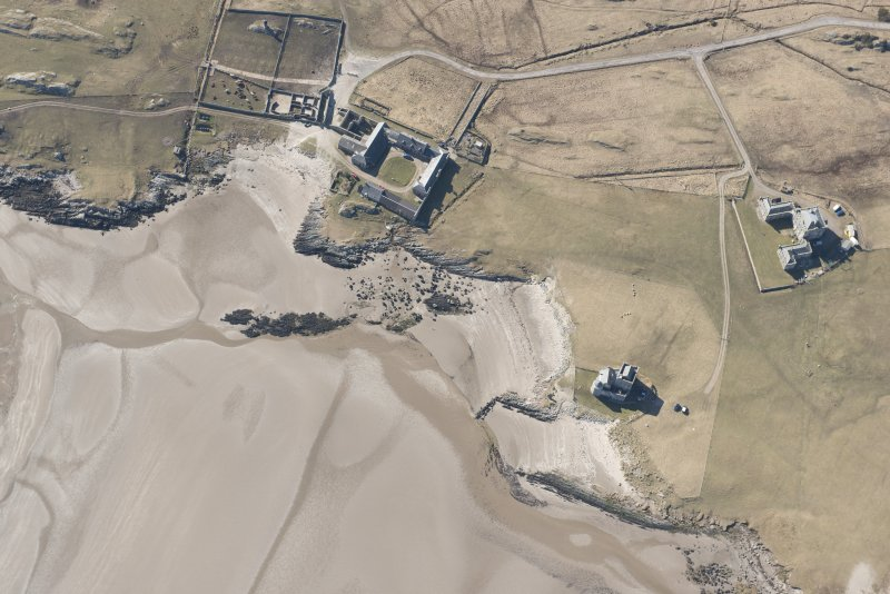 Oblique aerial view of Breachacha, Coll, looking W.