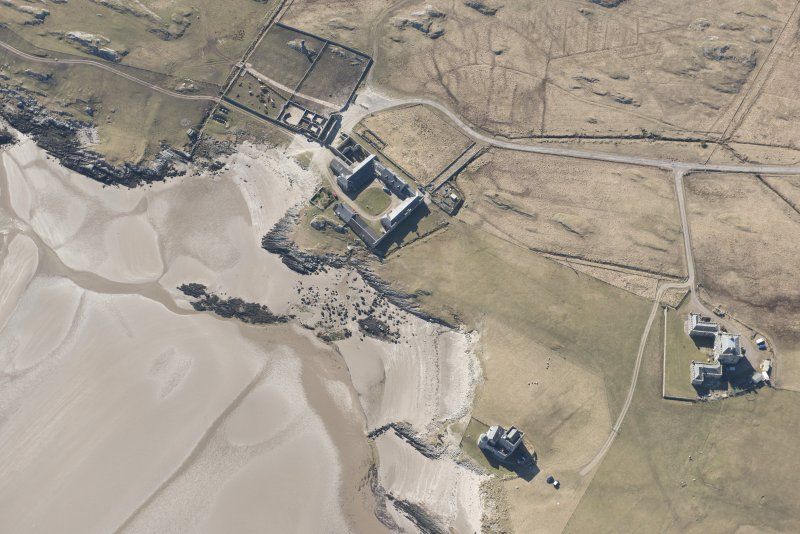 Oblique aerial view of Breachacha, Coll, looking SW.