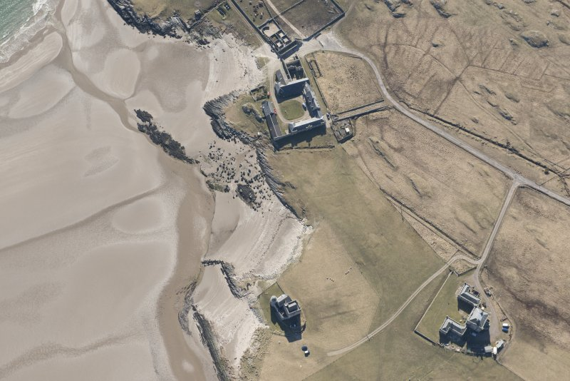 Oblique aerial view of Breachacha, Coll, looking SSW.
