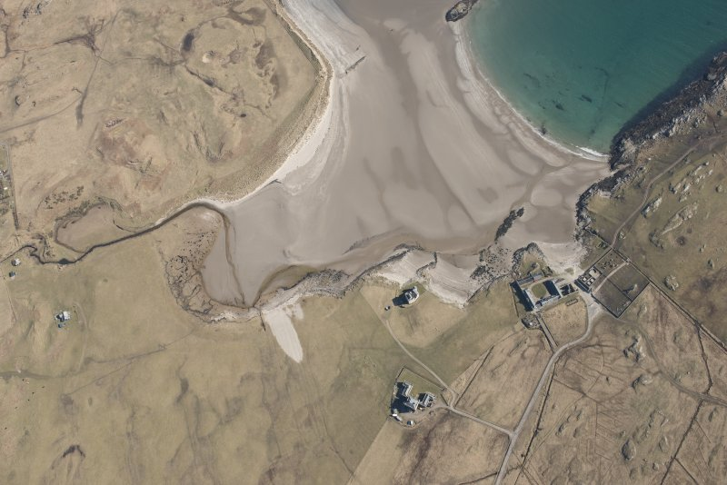 Oblique aerial view of Breachacha, Coll, looking SE.