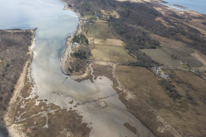 Oblique aerial view of the fish trap with Lochnell House beyond, looking SSW.
