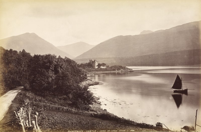 Distant view of Dunderave Castle from west,  Titled: 'Dunderave Castle, Head of Loch Fyne.  888 J.V.' PHOTOGRAPH ALBUM No. 33: COURTHAULD ALBUM