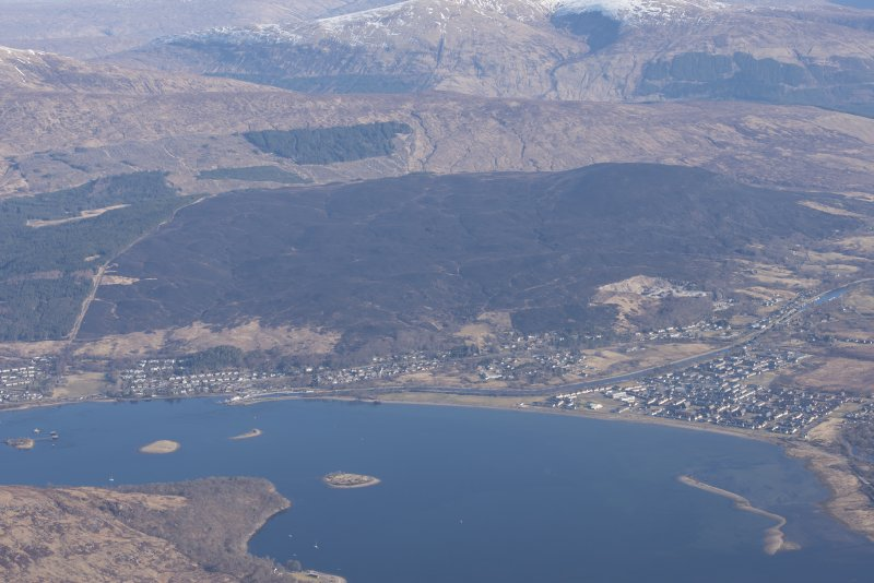 General oblique aerial view of Corpach, Fort William, showing the moorland burning beyond, looking NE.