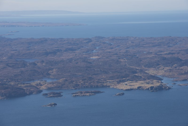 General oblique aerial view with the site of the Drumbeg wreck in the foreground and the west coast beyond, looking SSW.