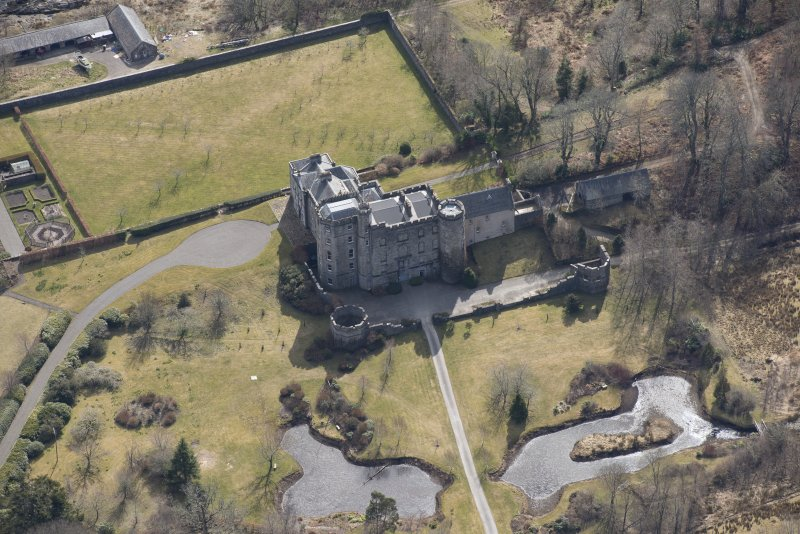 Oblique aerial view of Lochnell House, looking SE.