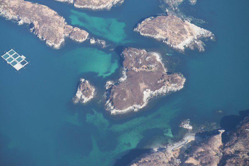Oblique aerial view of Eilean an Achaidh and the site of the Drumbeg wreck, looking N.