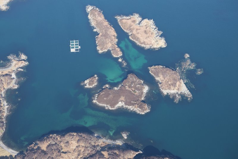 Oblique aerial view of Eilean an Achaidh and the site of the Drumbeg wreck, looking NNW.