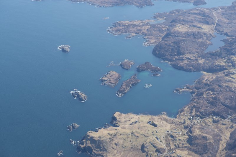 General oblique aerial view of Eddrachillis Bay centred on Eilean an Achaidh and the site of the Drumbeg wreck, looking E.
