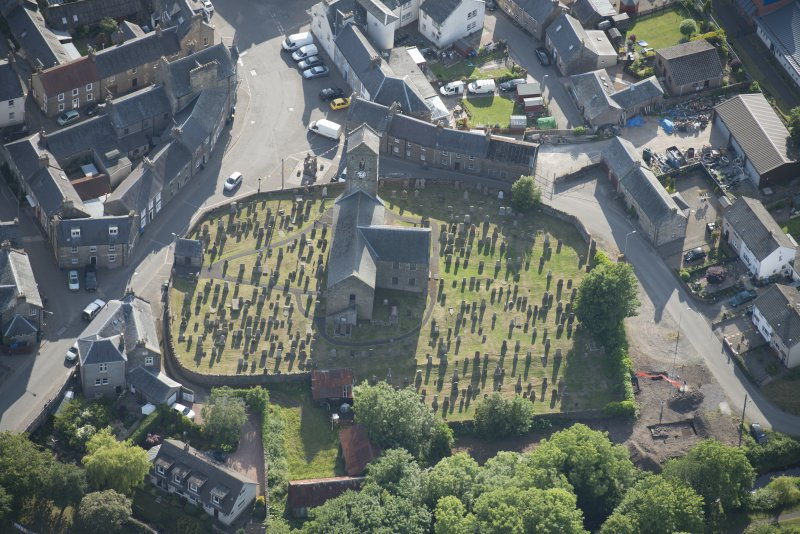 Oblique aerial view of St Serf's Church with the Glasgow University excavations on the edge of the churchyard, looking W.