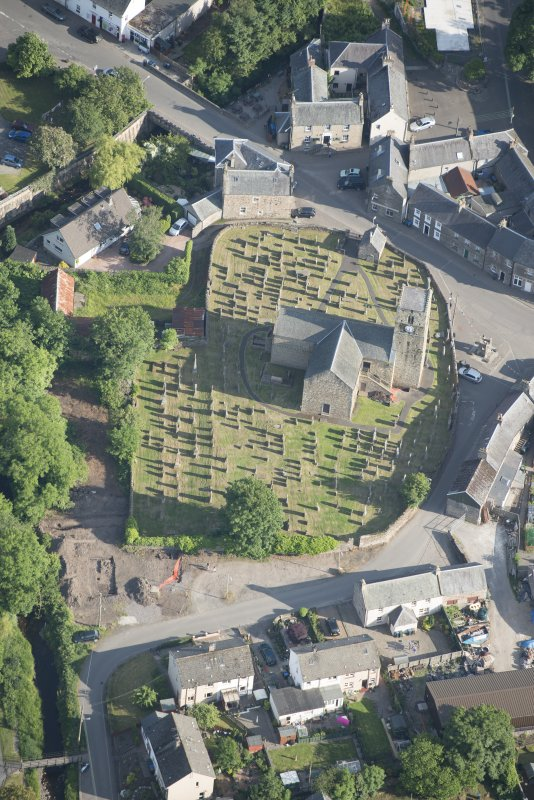 Oblique aerial view of St Serf's Church with the Glasgow University excavations on the edge of the churchyard, looking S.