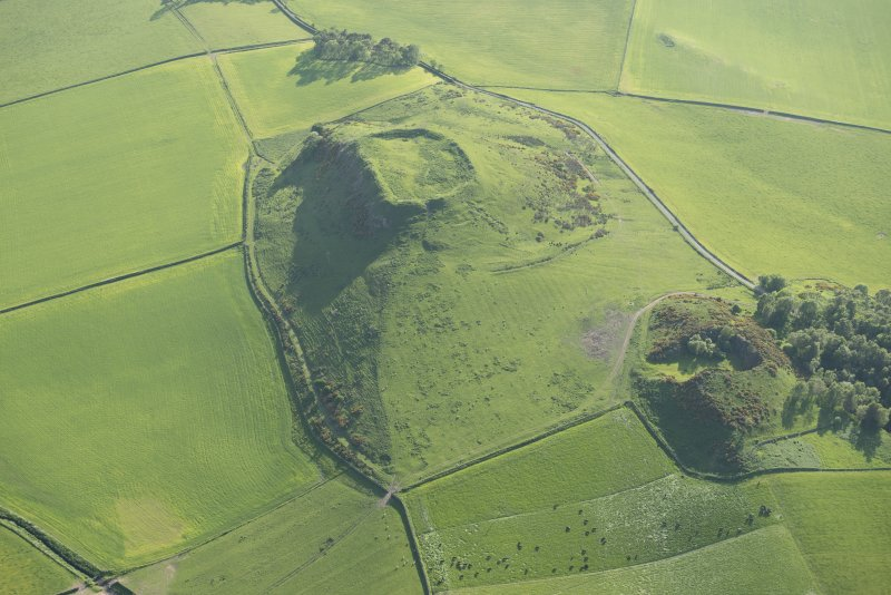 Oblique aerial viewof Denoon Law fort, looking WSW.