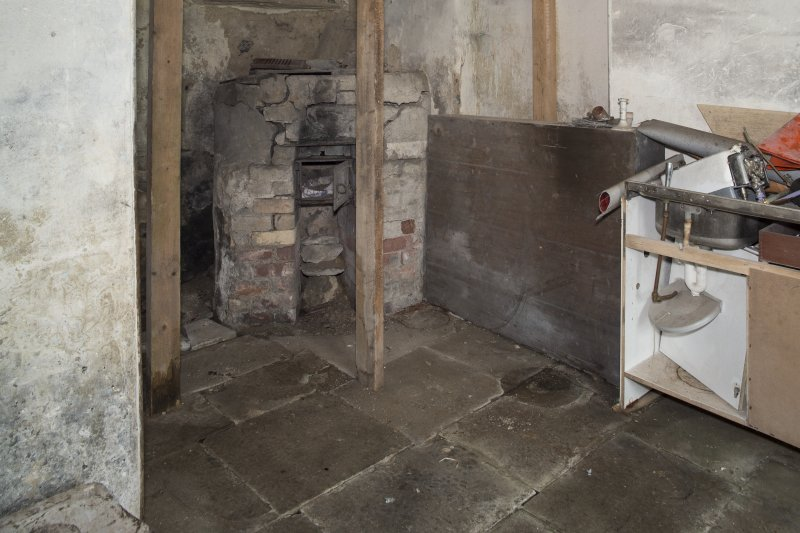 Ground Floor General view of wash house showing boiler and flagged floor.