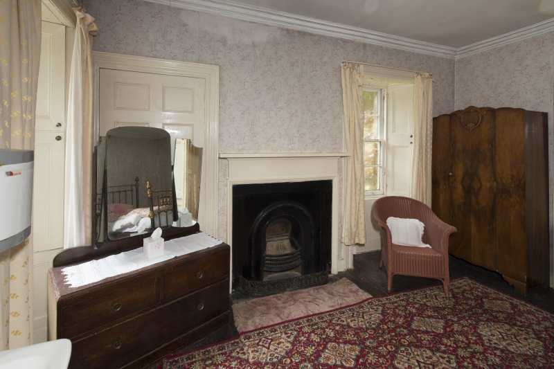First Floor General view of bedroom 5 showing fireplace and window.