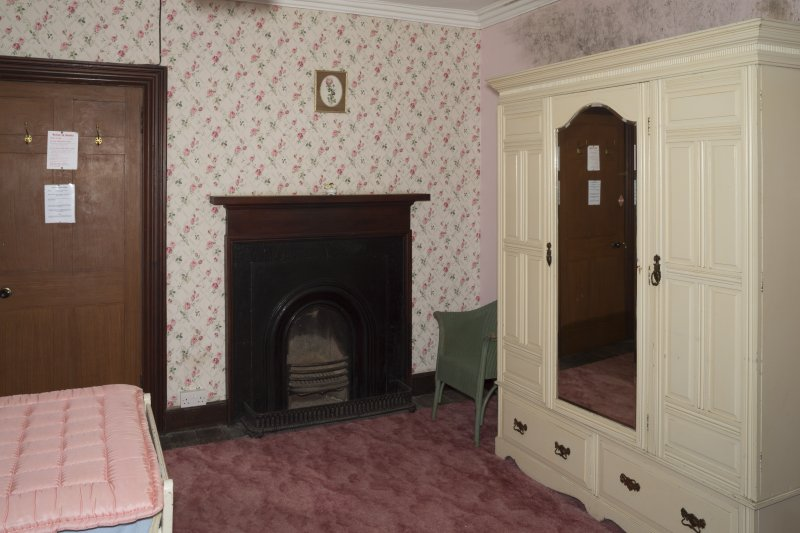 First Floor General view of Bedroom 7 showing fireplace.