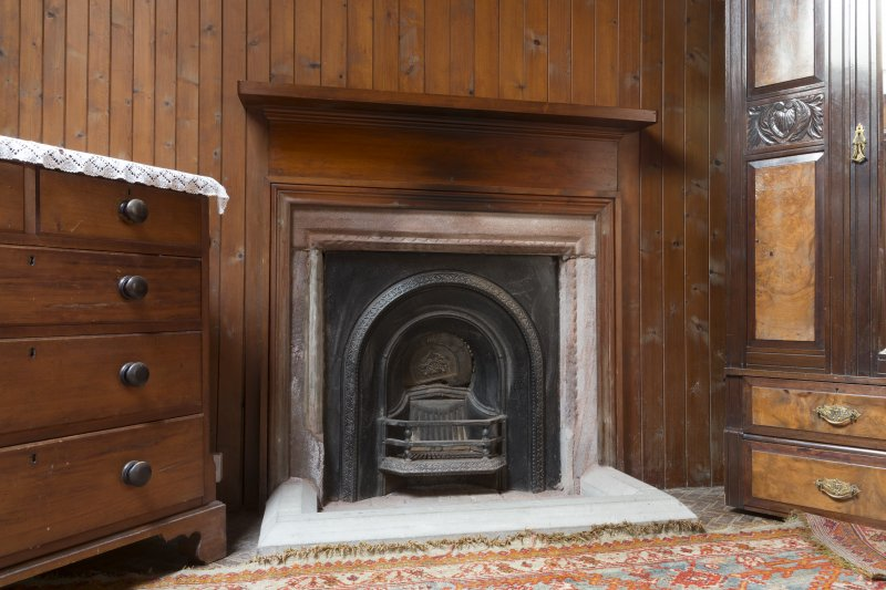 Second Floor General view of fireplace and panelling in Library.