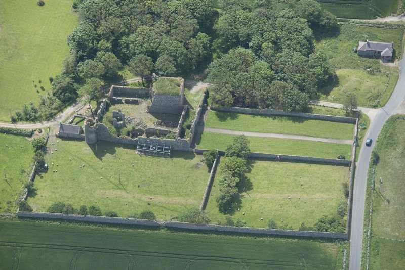 Oblique aerial view of Pitsligo Castle, looking SSE.