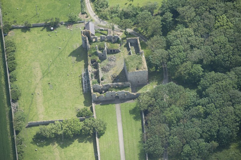 Oblique aerial view of Pitsligo Castle, looking E.