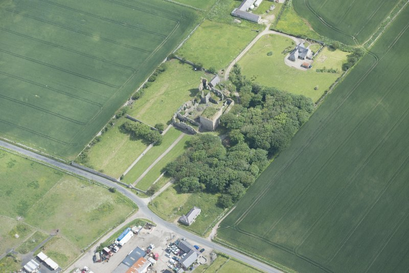 Oblique aerial view of Pitsligo Castle, looking NE.