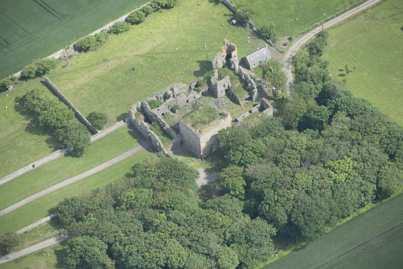 Oblique aerial view of Pitsligo Castle, looking NNE.