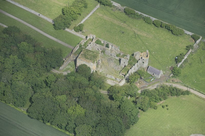 Oblique aerial view of Pitsligo Castle, looking NNW.