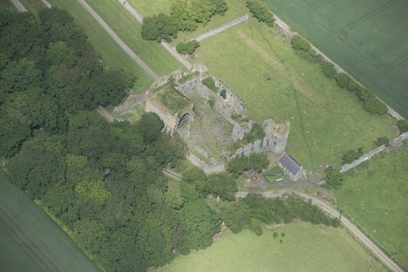 Oblique aerial view of Pitsligo Castle, looking NW.
