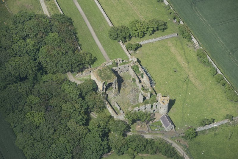 Oblique aerial view of Pitsligo Castle, looking WNW.