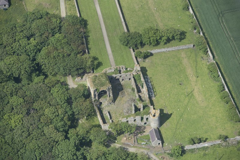 Oblique aerial view of Pitsligo Castle, looking W.