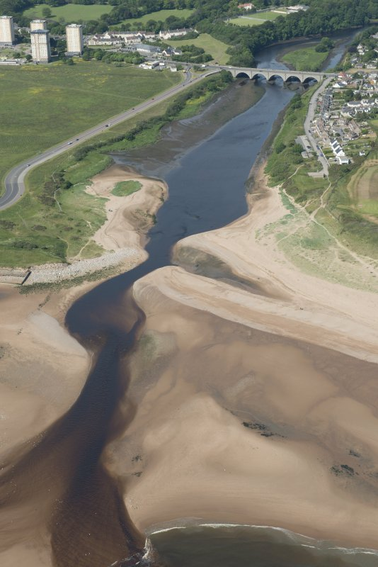 General oblique aerial view of the mouth of the River Don with the Bridge of Don in the background, looking SW.