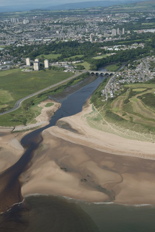 General oblique aerial view of the mouth of the River Don with the Bridge of Don and St Ninian's Place tower blocks in the background, looking SW.