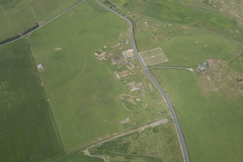 Oblique aerial view of Tershinty Camp on the former site of Fraserburgh Airfield, looking NW.