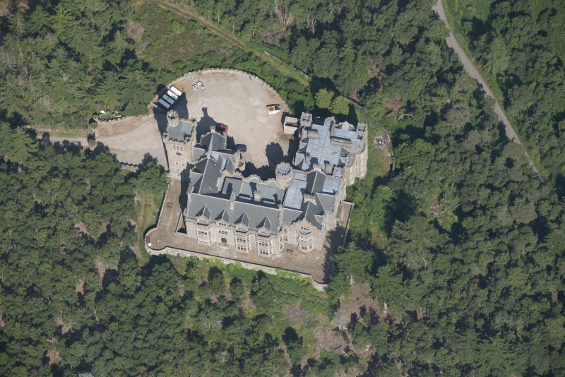 Oblique aerial view of Carbisdale Castle, looking NW.