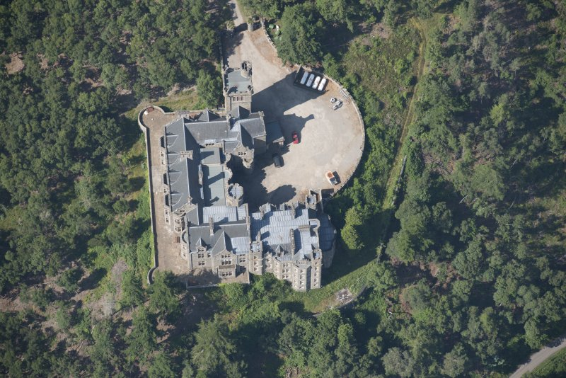 Oblique aerial view of Carbisdale Castle, looking WSW.
