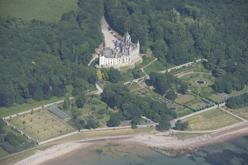 Oblique aerial view of Dunrobin Castle and walled garden, looking N.