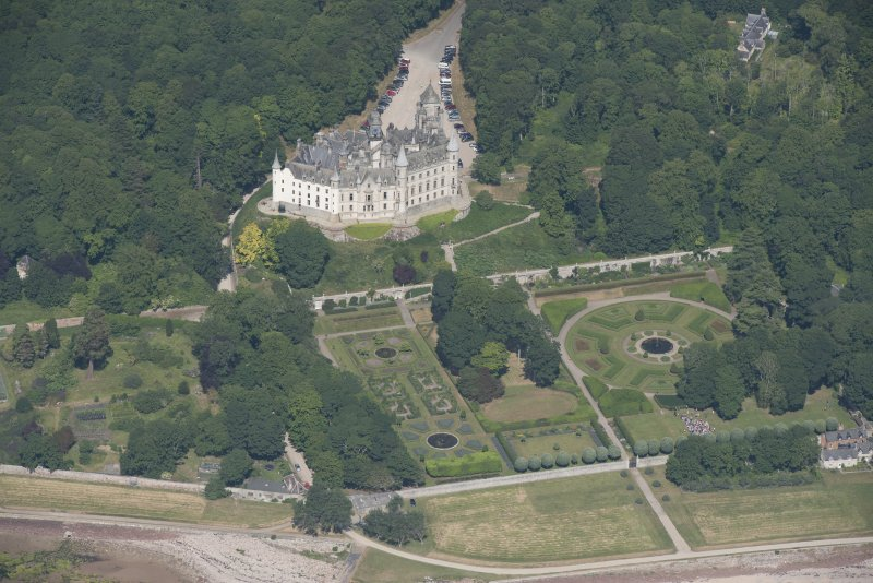 Oblique aerial view of Dunrobin Castle and walled garden, looking NNW.