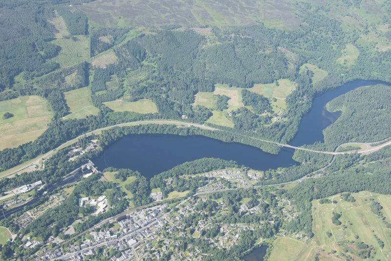 Oblique aerial view of Pitlochry, Power Station and Dam, Coronation Bridge and Loch Faskally Reservoir, looking WSW.