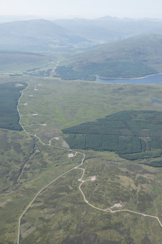 General oblique aerial view of Glen Errochty showing the route of the Creiff to Dalnacardoch Military Road and the construction of the Beauly to Denny power line, looking SSW.