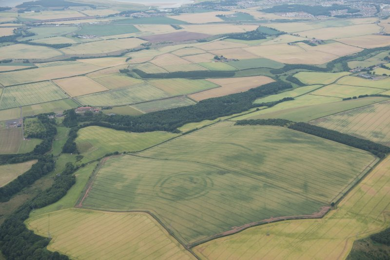 General oblique aerial view of the cropmarks of the fort at The Chesters, Spott, looking NNE.